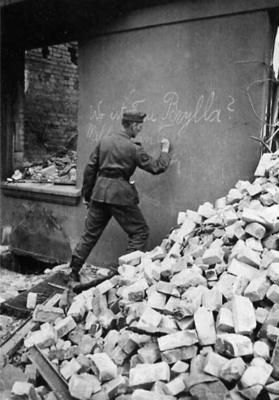 """""""Wall mail"""" A german soldier on furlough finds his home bombed, his family either evacuated or dead. It was common practice to leave a message on the walls of the ruins for either the relatives or neighbors."""