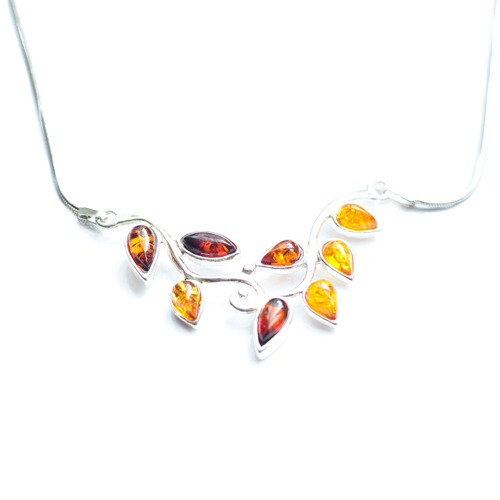 Beautifully shaped, this sterling silver necklace features a natural, leaf-like structure that houses multitude multi-coloured Amber stones on a snake-style integral silver chain. A mixture of natural beauty and fine craftsmanship.The Amber stones have been sculpted for centuries by the everlasting waves of the Baltic Sea, and are hand picked just off the shores of Poland.