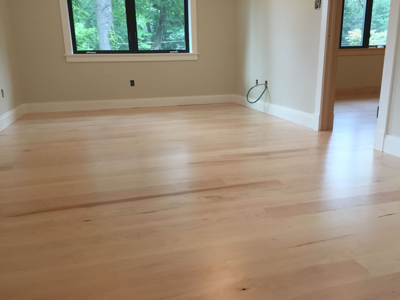 Locally milled 5 maple flooring finished with Bona