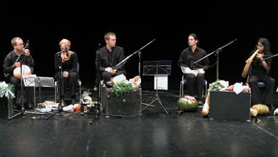 This is part of the vegetable orchestra from Vienna. Has the mouth of carrot, cucumber and red pepper body at the base to help project the sound. This orchestra does not throw food. When finished they brought him home and make soup.