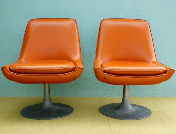 Vintage pair of saarinen style orange vinyl tulip lounge swivel