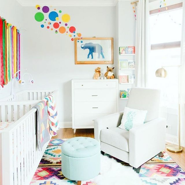 bright and colorful nursery with elephant art. White with