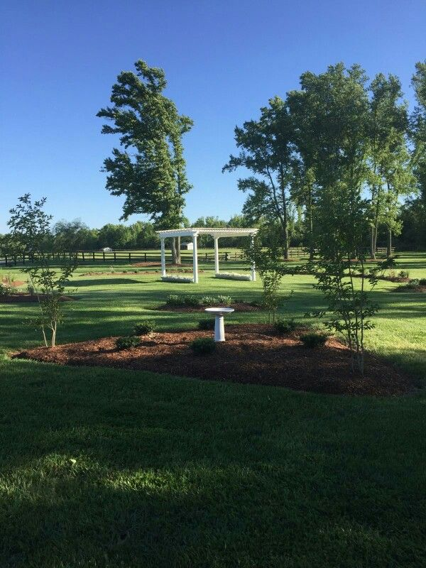 Alturia Farm pergola surrounded by lush pastures. Share your vows with family and friends gathered in the round.