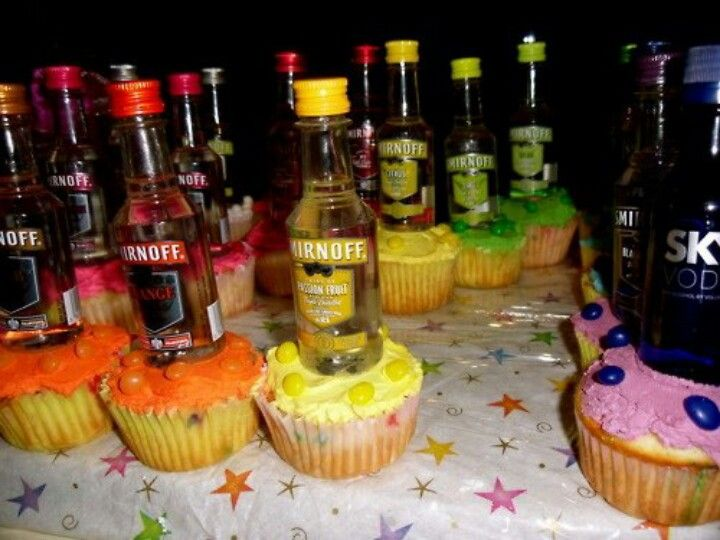colorful cupcakes with liquor bottles for 21st birthday treats