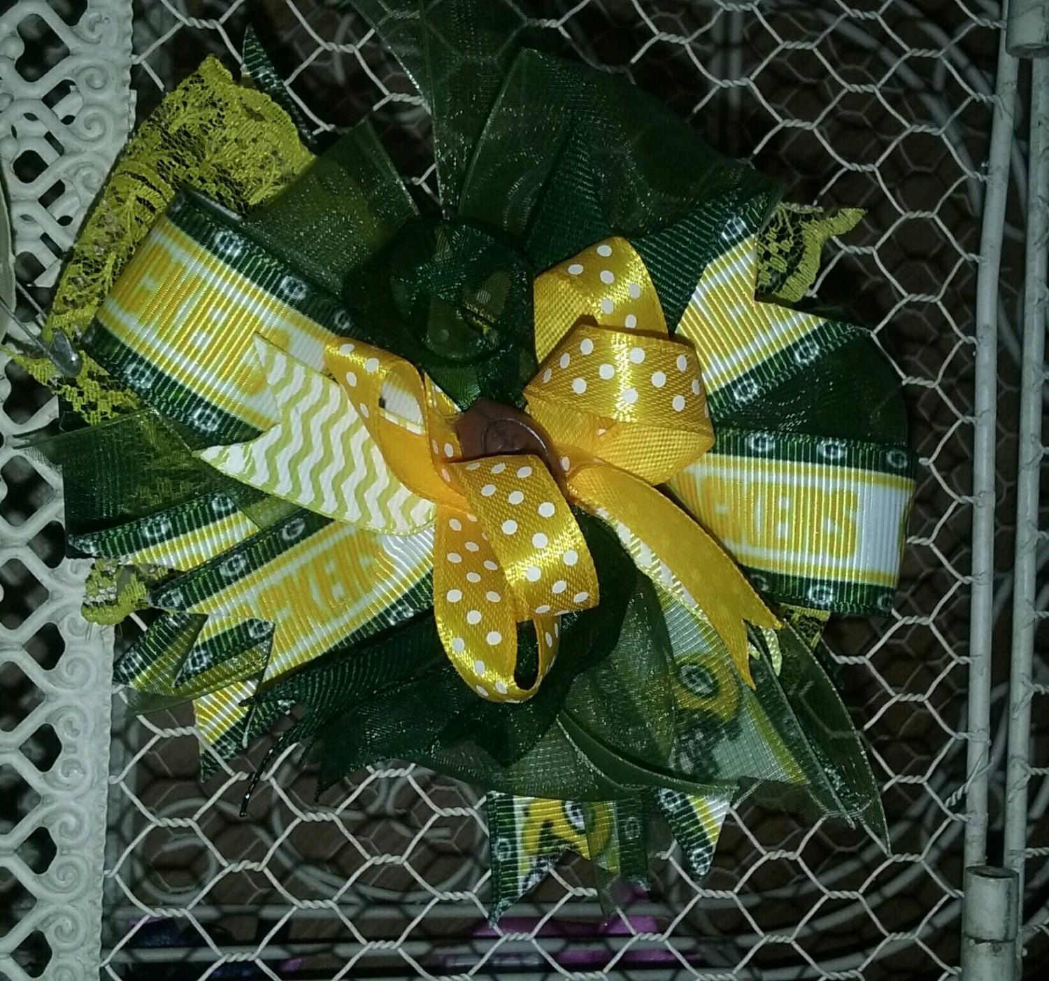 Over the top/sassy/  boutique style hair bow.Packers football by SweetDesignsbyCindy on Etsy