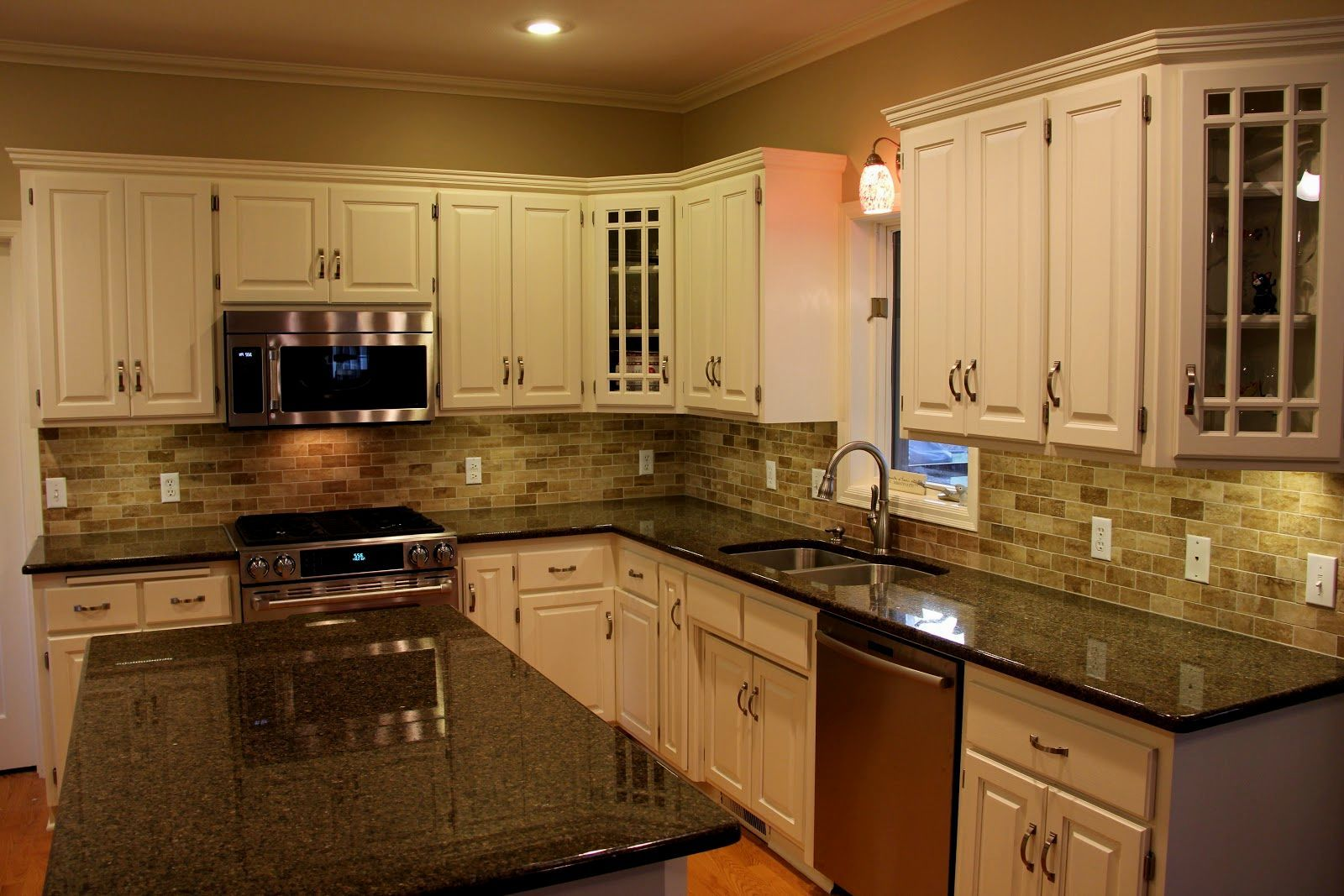 White Kitchen Cabinets With Green Granite Counters ... | Kitchen counter decor, Backsplash for ...