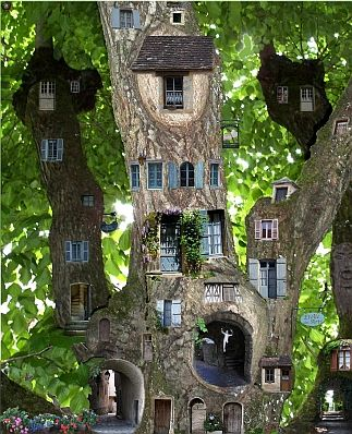 saw this on Facbook as a fairy garden..turned out to be digital art. Fairy  Tree HousesFairy ...