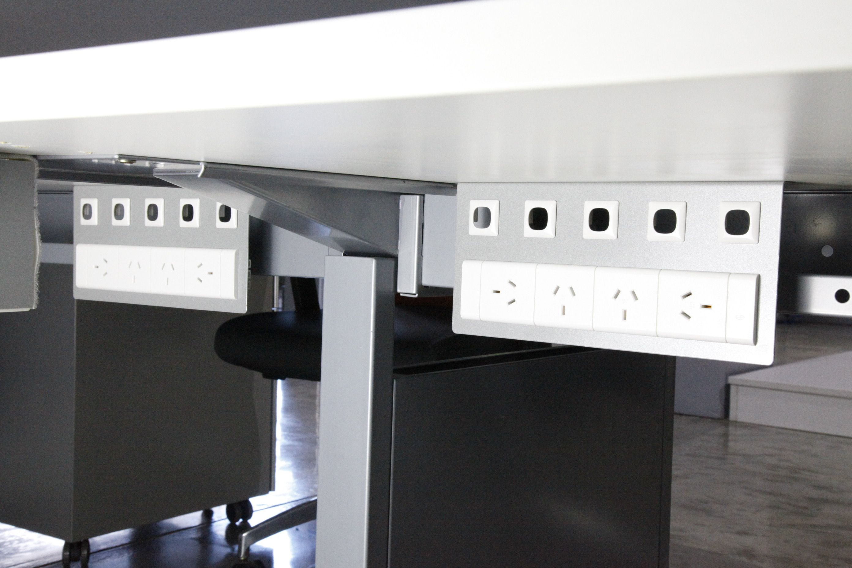 Mounting Plates Were Installed For An Under Desk Power Solutions