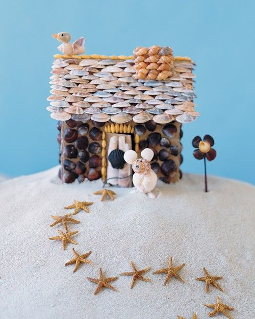 "Make a miniature seaside bungalow by crafting a cardboard ""house"" covered in shells from the shore."