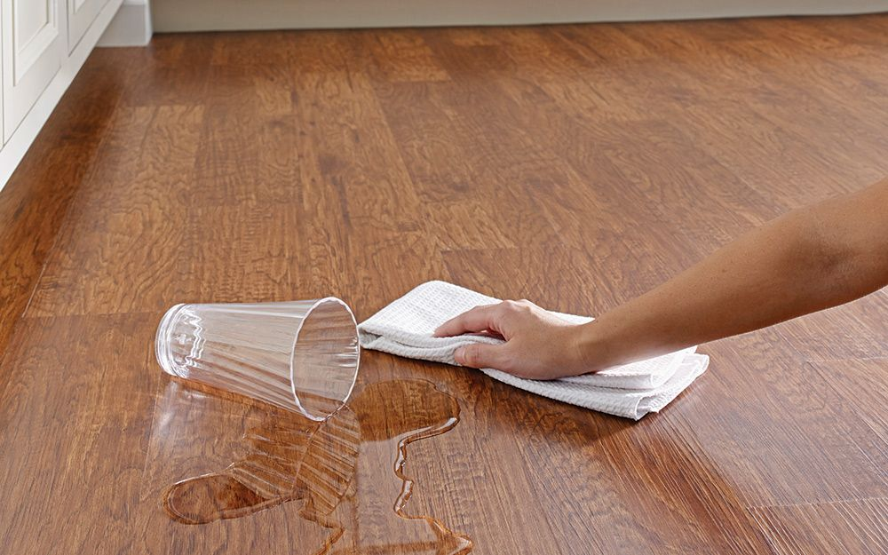 Someone Easily Wiping Up A Water Spill With A Towel On An Easy Care Vinyl Floor Vinyl Flooring Vinyl Plank Flooring Best Vinyl Flooring