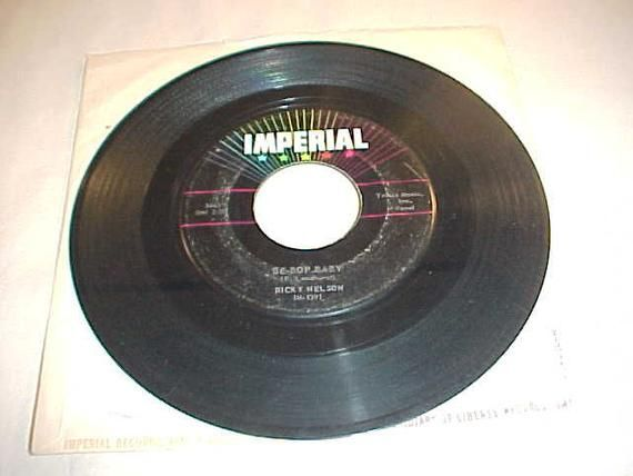 Artist:  Ricky Nelson         45 Vinyl Record            Record Grade:  VGTitle:  Be-Bop Baby / Have I Told You Lately That I Love YouLabel:  Imperial Records 5463Release Date: 195845-1125