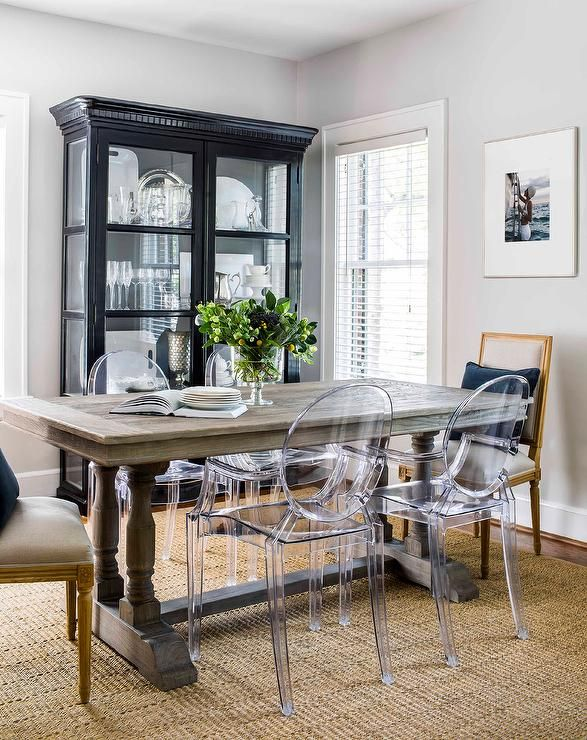 Small Living Room Boasts A Ghost Dining Chairs Placed On A Seagrass Rug In Front Of A Ghost Chair Dining Room Dining Room Design Dining Room Table Centerpieces