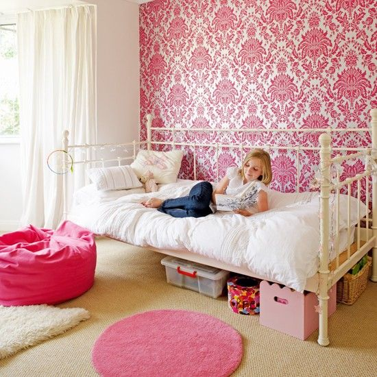 A Chic Feature Wall In Hot Pink Damask Wallpaper Is A Great Way To Give A