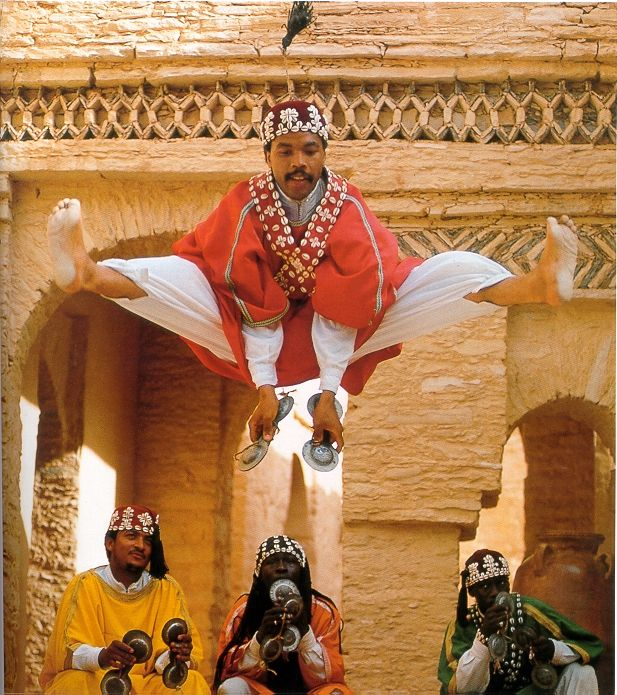 "Gnawi in Agadir, Moracco.  The Gnawi are performers of ""ancient African Islamic spiritual religious songs and rhythms. Its well preserved heritage combines ritual poetry with traditional music and dancing...dedicated to prayer and healing.""  They are the descendants of black African slaves brought into Morocco after the fall of Timbuktu in 1591. Sources:  Wikipedia.org and http://www.ibiblio.org/gnawastories/"