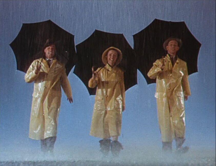 """Gene Kelly (1912-1996), Debbie Reynolds (*1932) und Donald O'Connor (1925-2003) im Filmmusical """"Singin' in the Rain"""" (1952). Dieser Film gilt als einer der besten Musical-Filme aller Zeiten."""