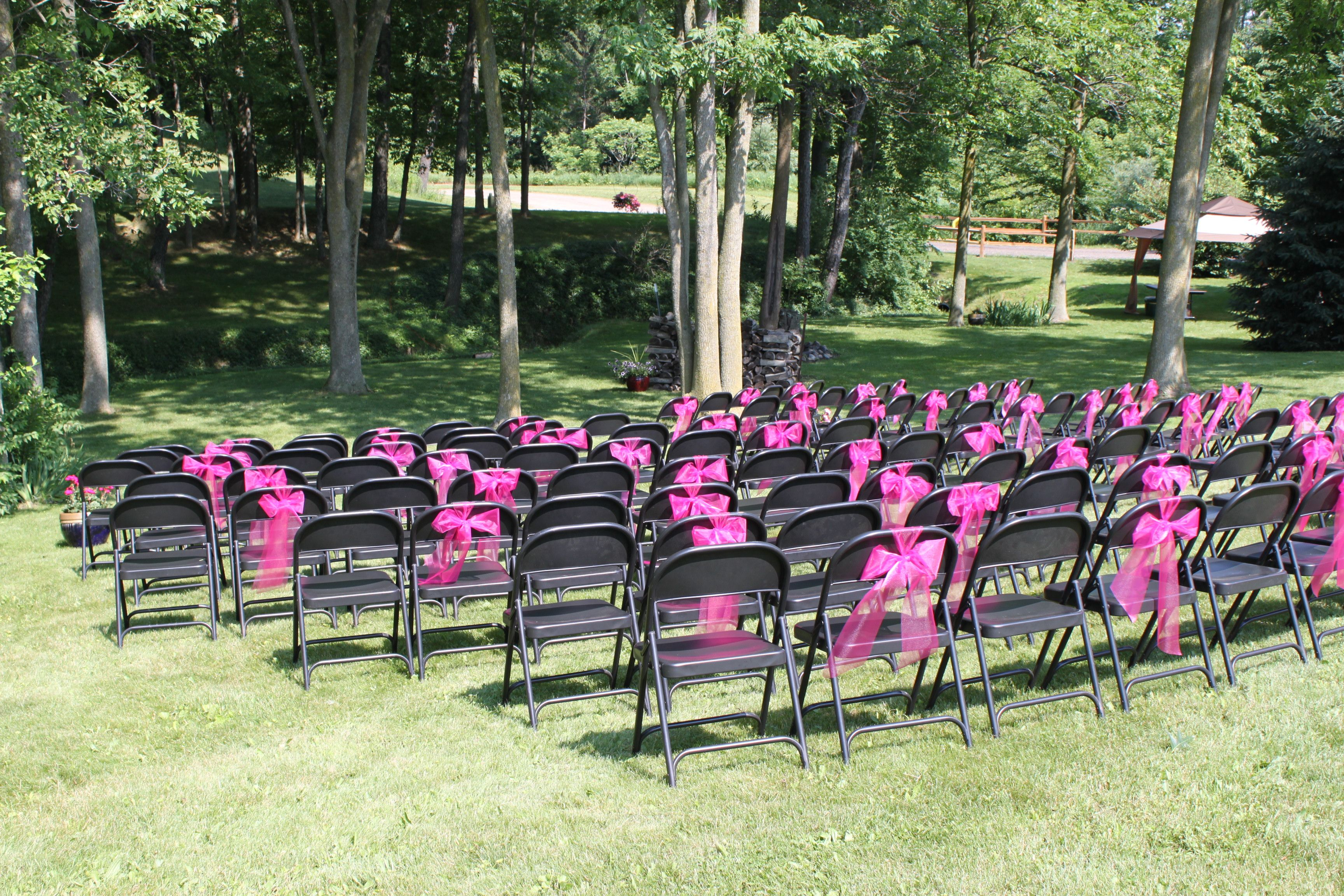 Ordinary Folding Chairs Dressed Up With Hot Pink Tulle Bows For An