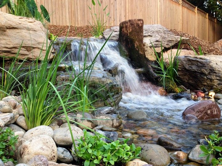Waterfall To Spice Up Your Backyard Waterfalls Backyard Backyard Water Feature Pond Landscaping
