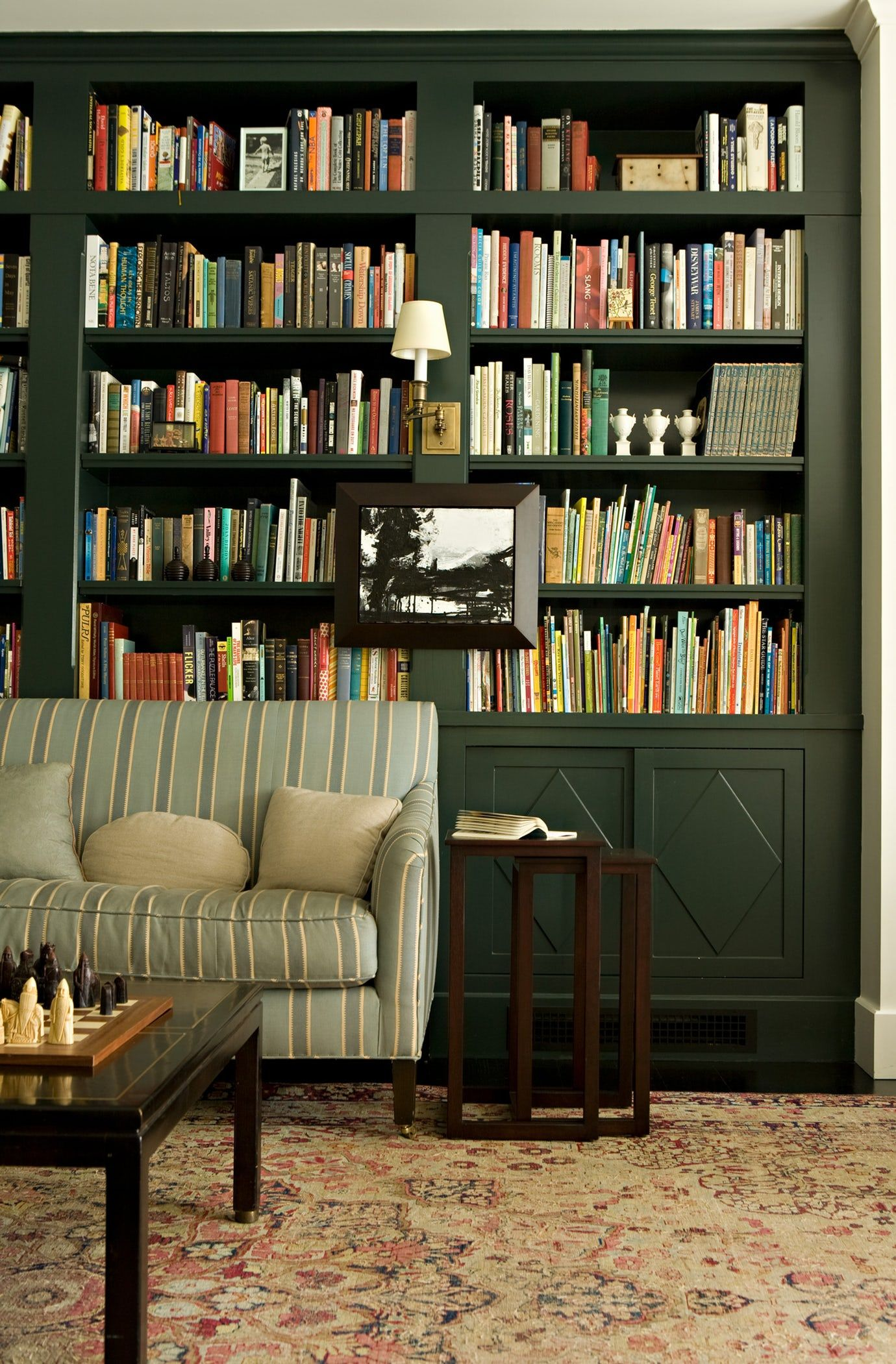 Hunter Green Built In Bookcases Dark Green Home Library Antique Rug Sconces On The Bookcases Ti Home Library Design Green Bookshelves Built In Bookcase