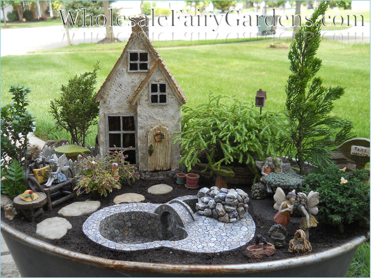 Now that is one AWESOME display! Fairy garden houses