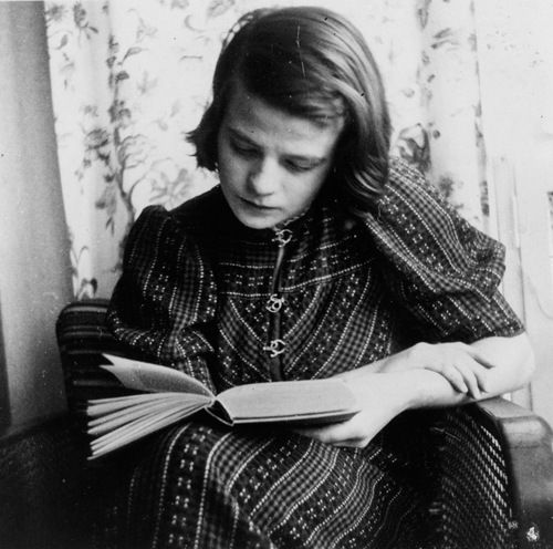 "books0977:  Sophia Magdalena Scholl reading. Scholl (1921-1943) was a German student and revolutionary, active within the White Rose non-violent resistance group in Nazi Germany. She was convicted of high treason after having been found distributing anti-war leaflets at the University of Munich with her brother Hans. As a result, they were both executed by guillotine. Her last words were ""Die Sonne scheint noch""—""The sun still shines."""