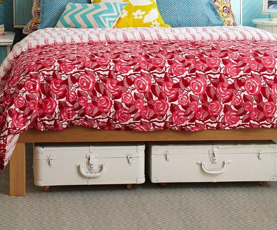 Great storage idea - paint old suitcases and add casters...