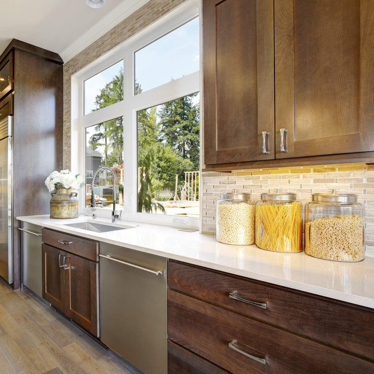 Best Kitchen Backsplash Ideas For Dark Cabinets The Family Handyman In 2020 Brown Kitchen Cabinets Kitchen Design Dark Kitchen Cabinets