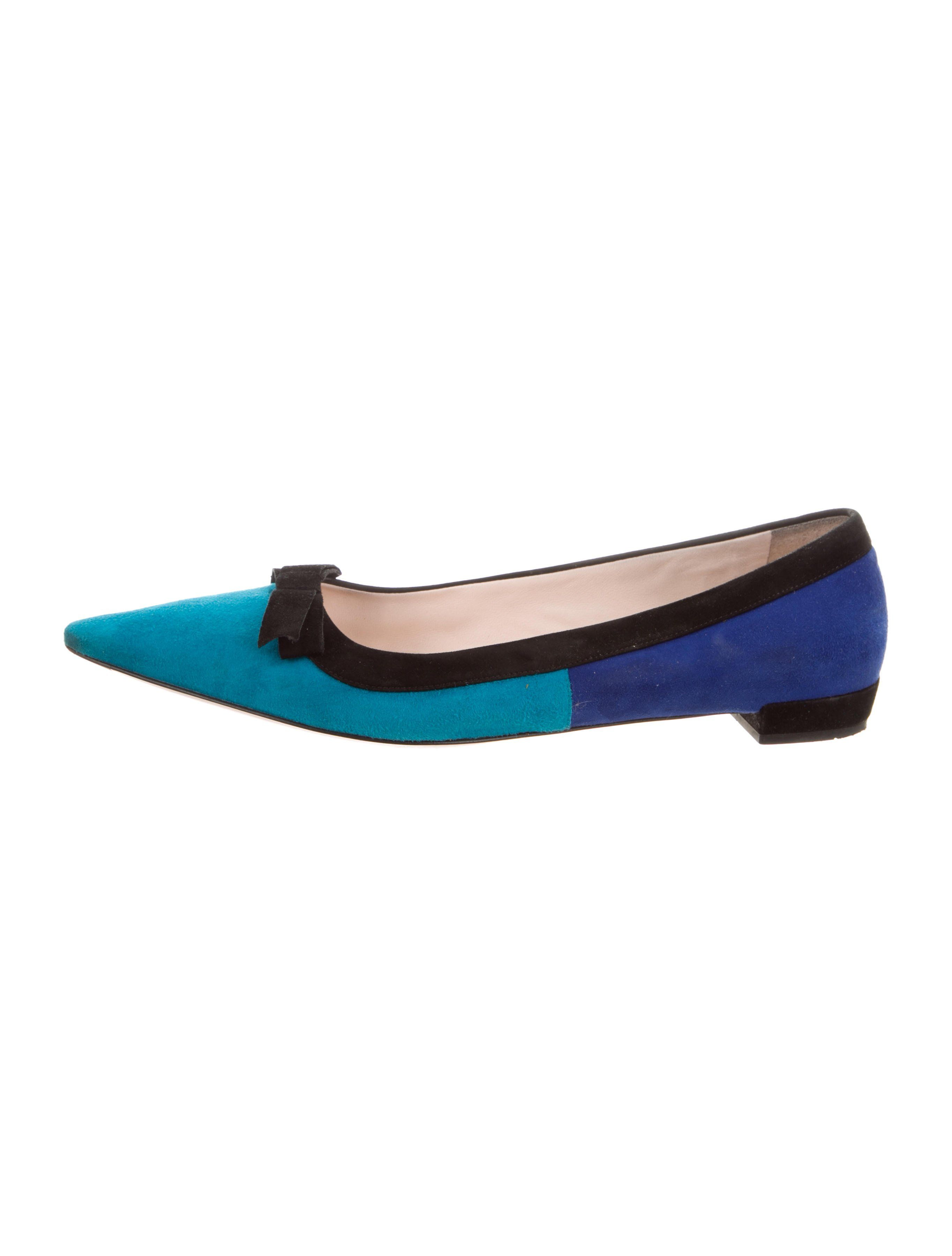 b1630839e Cerulean and cobalt suede Prada pointed-toe flats with black suede bow  accents at vamps and covered heels. Includes box.