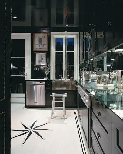 Black and white art deco kitchen with black cabinets