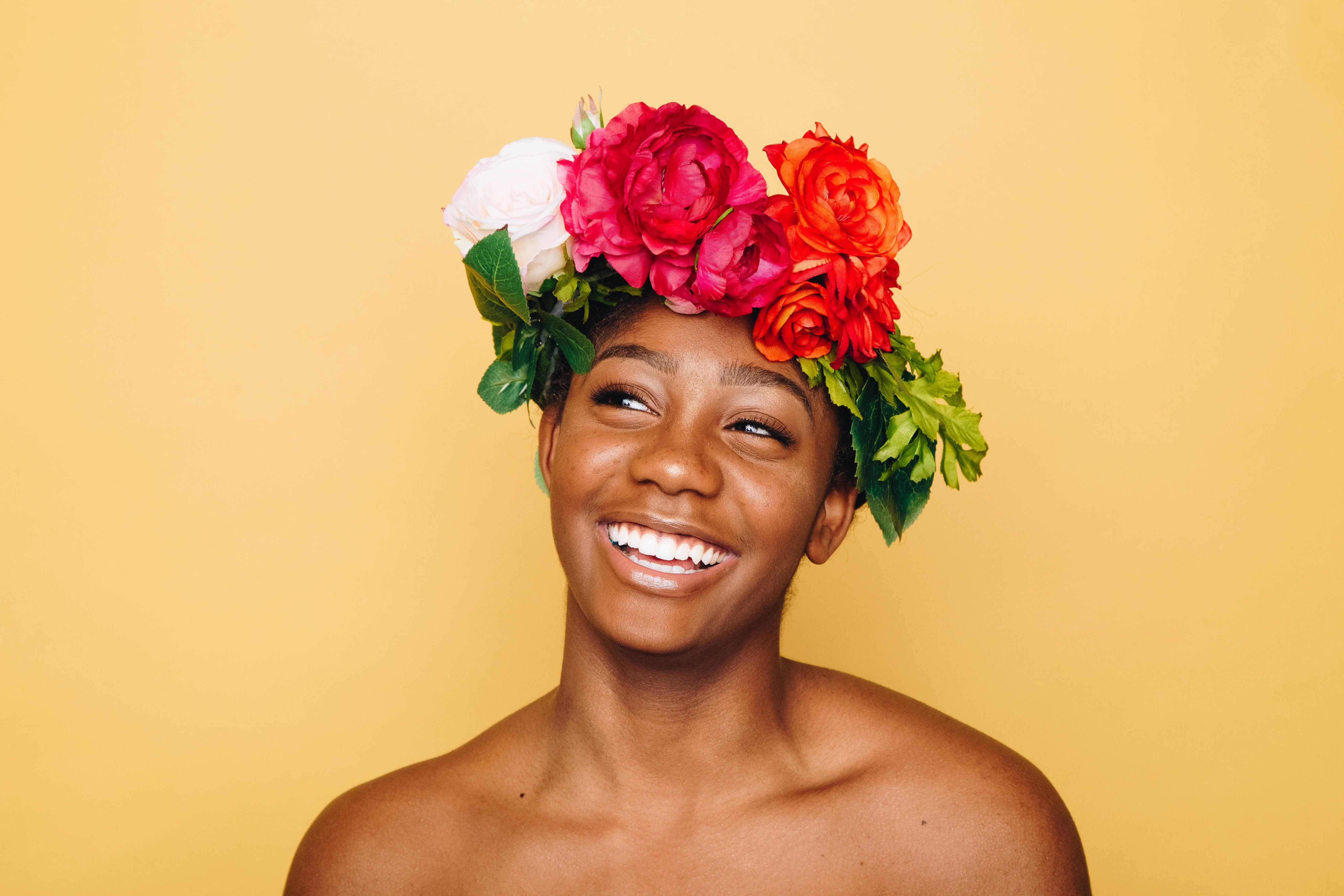 A smiling woman in a flower crown american mashup pinterest a smiling woman in a flower crown izmirmasajfo