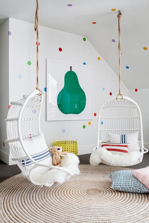 Colorful Contemporary Girls Bedroom Features Two Serena Lily White Hanging Rattan Chair Hung From A Sloped Ce Kid Room Decor Kids Room Inspiration Girl Room
