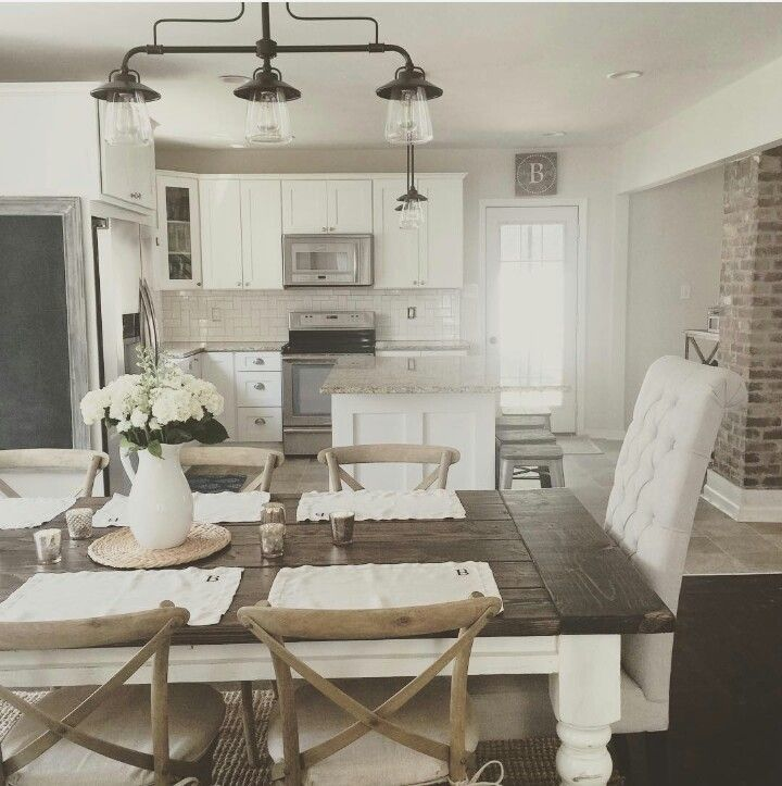 White wood and metal my favorite the light fixture is really nice and i love the color of the brick in this neutral modern farmhouse kitchen