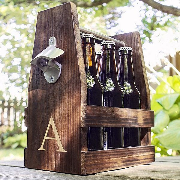 Personalized rustic wood craft beer bottle carrier on picnic table