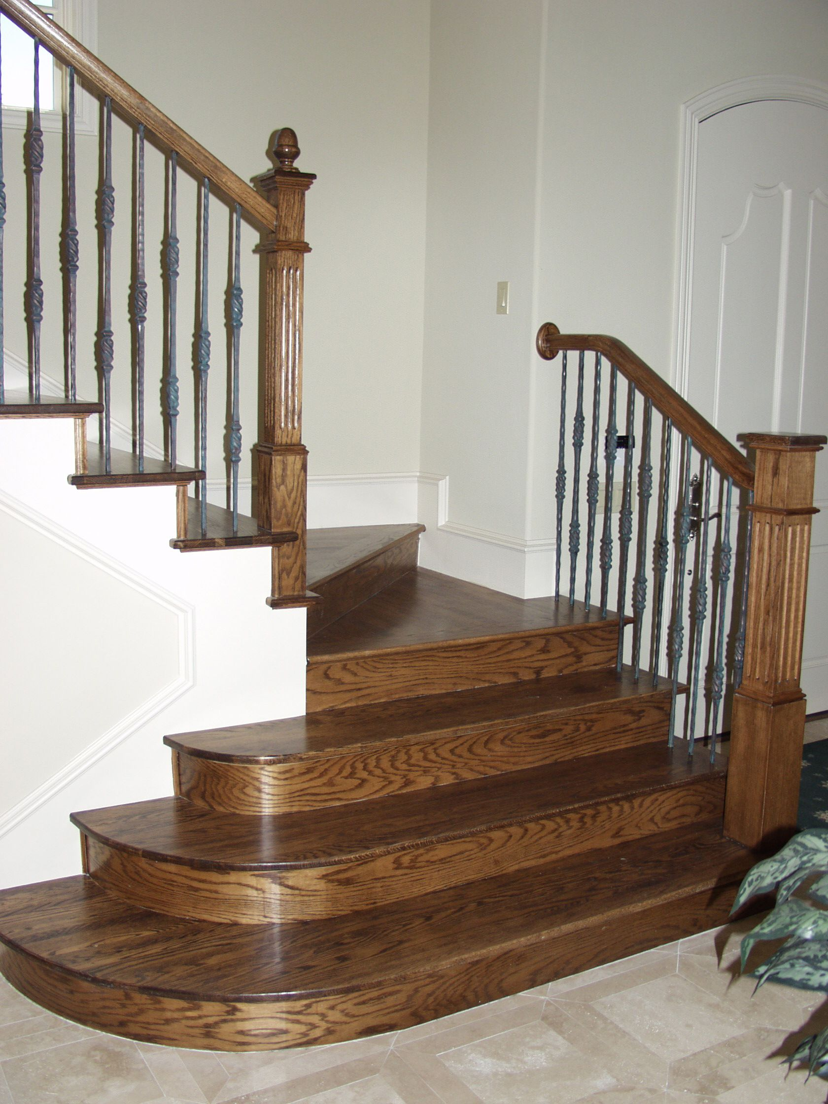 This staircase design was created using Tuscan square hammered