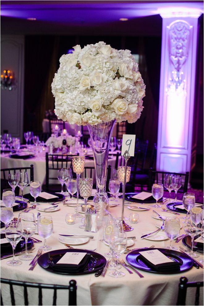 tall rose center piece black white tablescape white rose centerpiece modern wedding decor decor plants n petals venue hotel zaza photo - Black Hotel Decoration