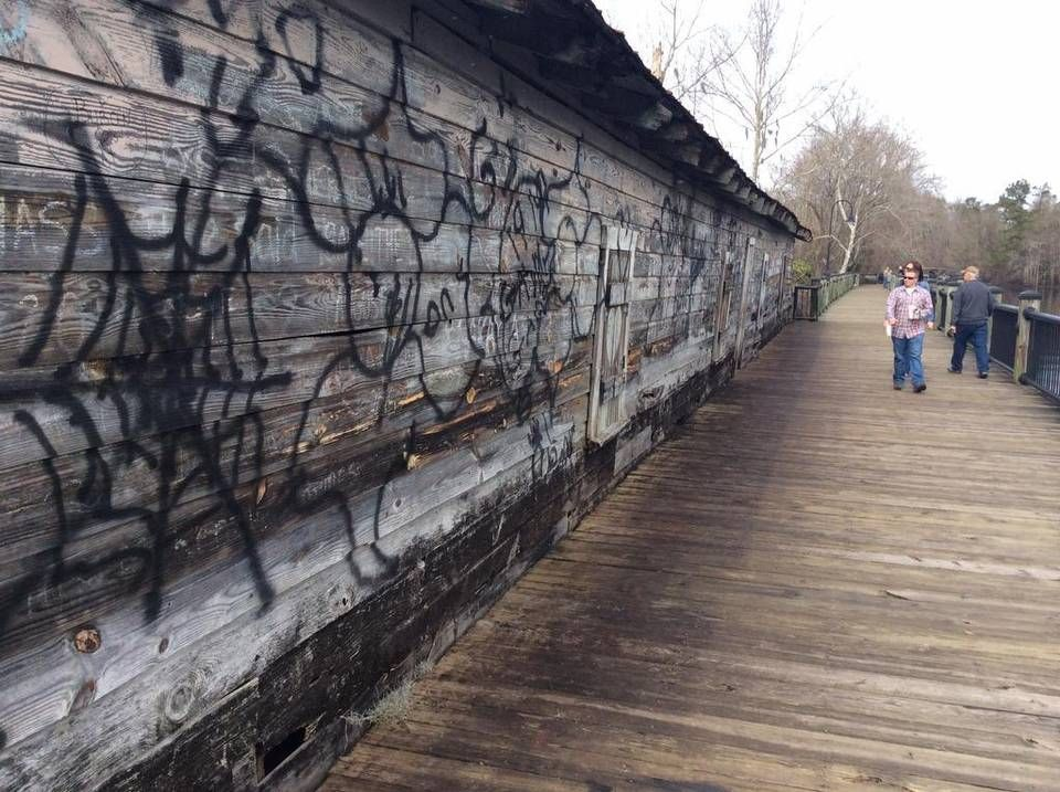Crystal Loftin of Loris looks at the vandalism done to the