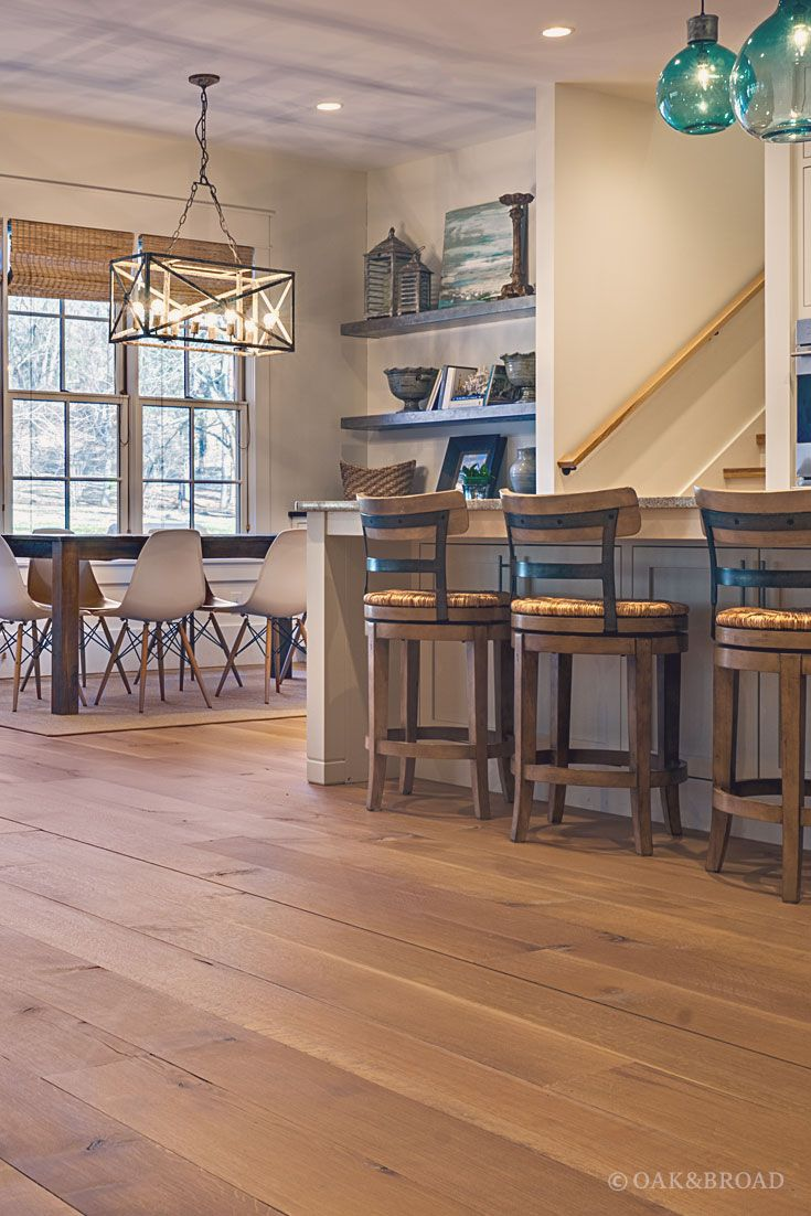 wide plank white oak flooring. Wide Plank White Oak Hardwood Floor By And Broad With Custom Stain | View From Rustic Modern Kitchen Into Dining Area Eames Chairs Geometric Flooring