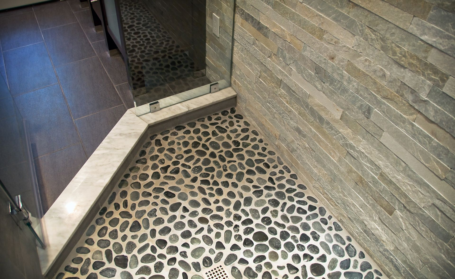 Rock Looking Floor Tile   Our Shower Floor Is Covered In Smooth Black River  Rocks. They Feel ...   Pool Bath   Pinterest   Stone Tile Flooring, Stone  Tiles ...