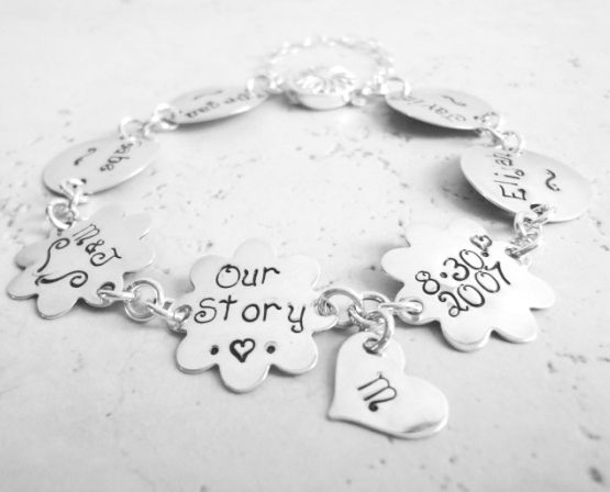 Customize this sterling silver hand stamped Our Story Charm Bracelet with your children's name or initials, you and your spouse initials and wedding date. The bracelet comes with a small heart that can be hand stamped with your last name initial.