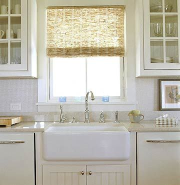 Farmhouse sink, sparkling faucets, and I love the bamboo window treatment. Am thinking about these for my house.