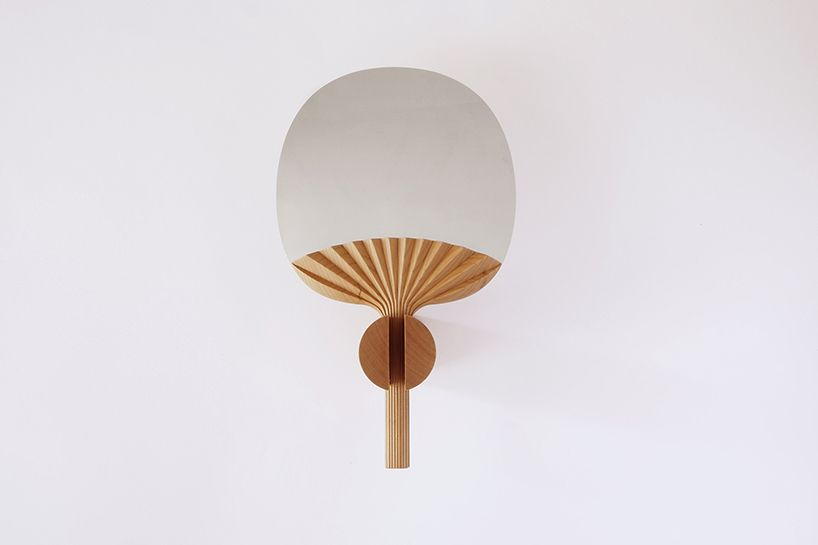 the self portrait mirror references japanese fans, proposing it as a feminine accessory symbol of luxury and beauty with carved pleats on the wooden handle.