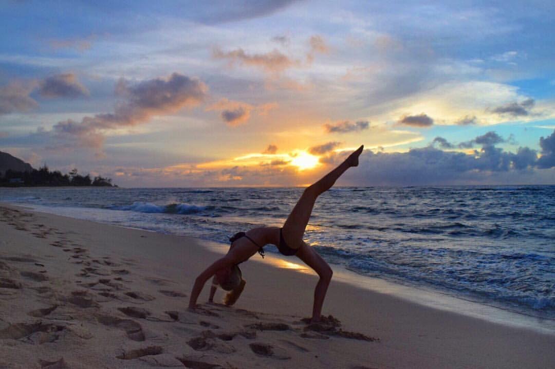 See this Instagram photo by @caninesoul • yoga wheel pose variation Oahu Hawaii rainbow sunset ocean waves