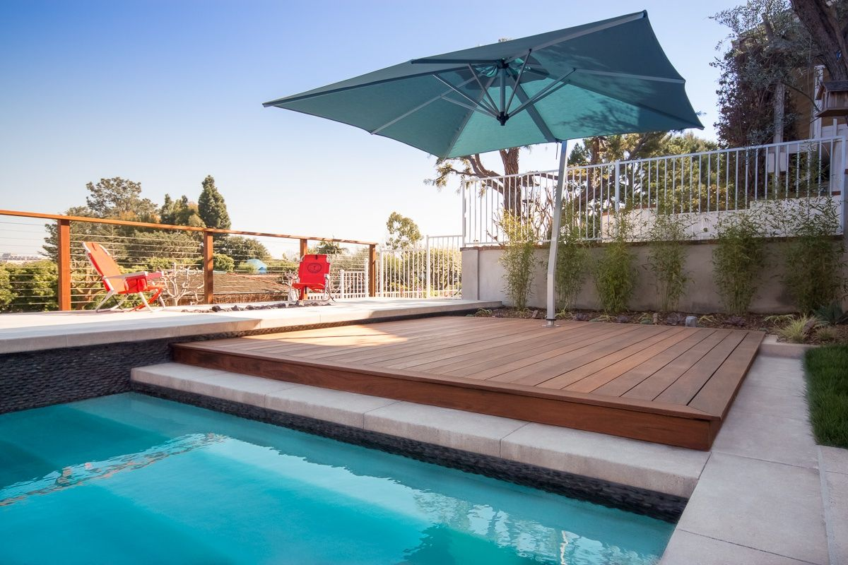 Raised Ipe Wood Deck And Umbrella Shade By The Pool Studio H Landscape Architecture Los Angeles Orange County Archite Pool Patio Wood Pool Deck Backyard Pool