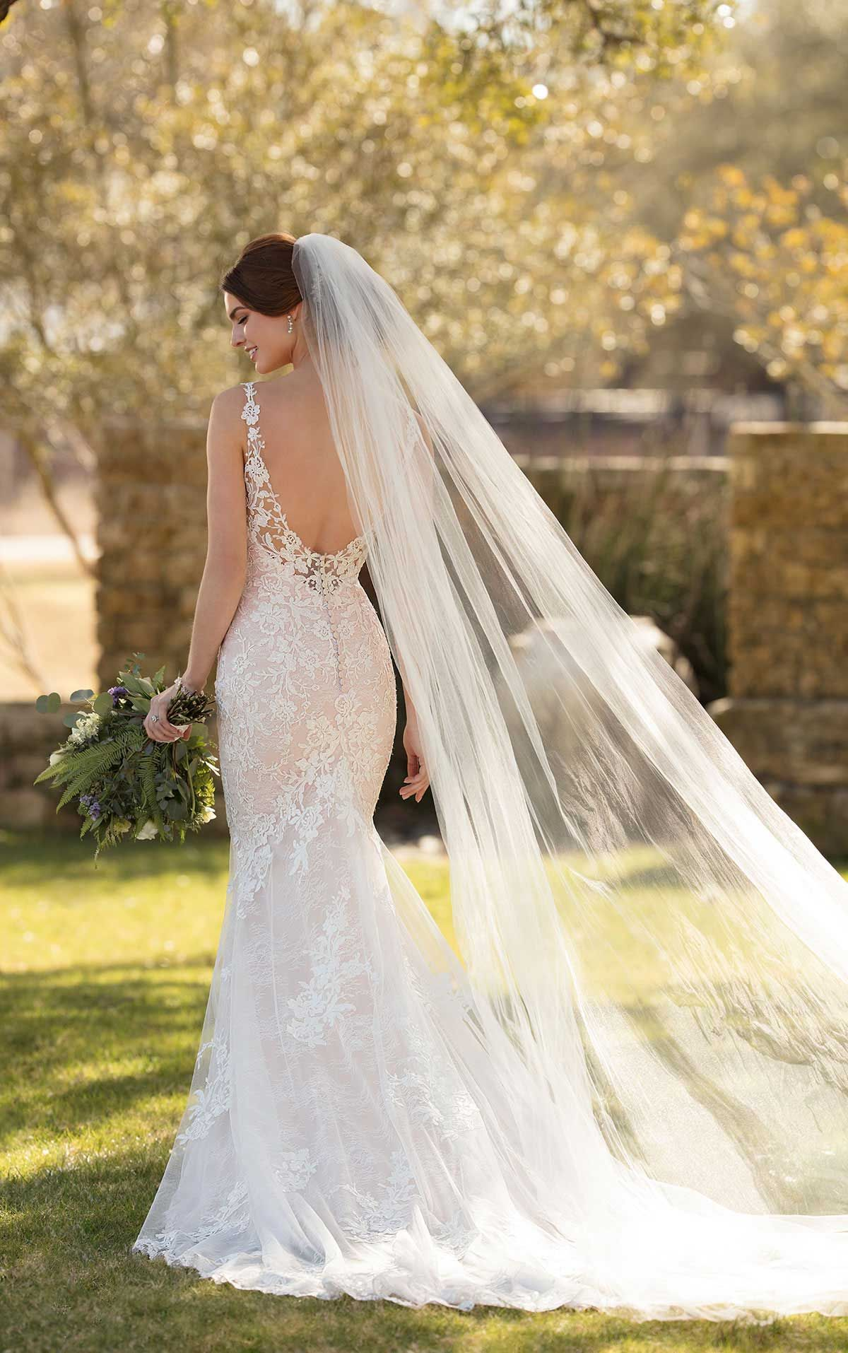 Low back lace mermaid wedding dress  Fit to flare lace wedding dress with a low back and illusion