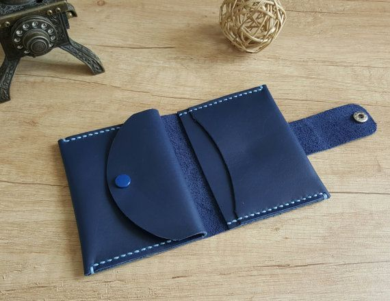 Photo of Small handmade leather bifold wallet with round flap closure cut …