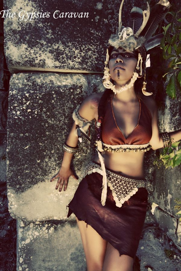 Headdress, Leather wraps, dreamcatcher hairpin, Dreamcatcher plugs, Crescent Moon Plug, Gypsy Halter Top, Rabbit Fur Armband, leather chokers, and finally leather shoulder bag~  All creations made by my hands <3  Creator/Designer/Photographer:  The Gypsies Caravan Jewelry-Photography  Model: Cassandra Wahuhi
