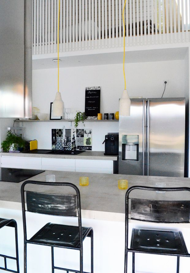 kitchen - concrete countertops, metal bar stools
