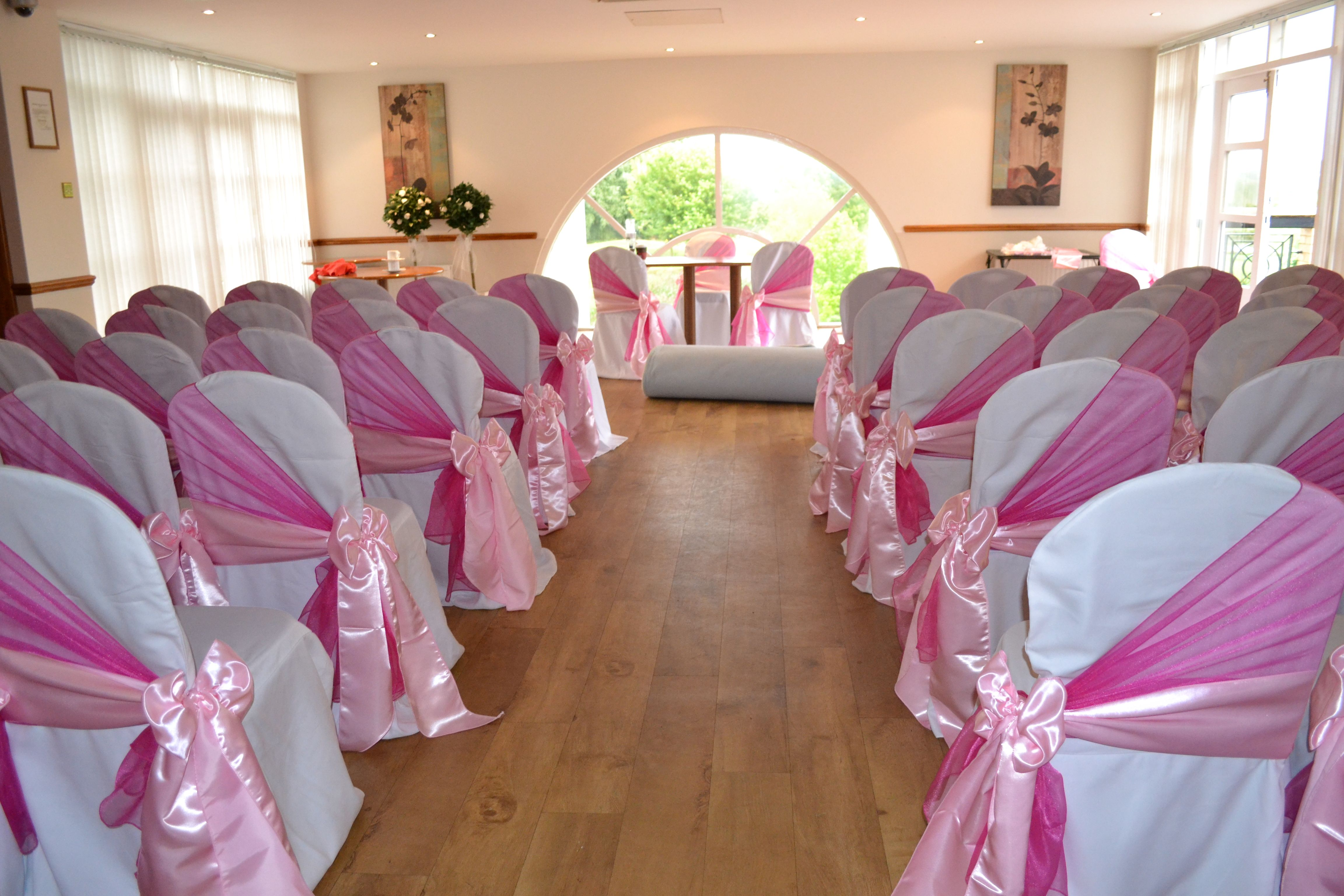 Fuschia organza shawls and baby pink satin bows on white