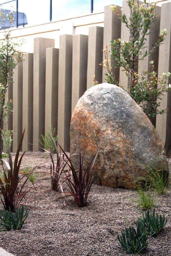 Drough Tolerant Plantings Of Coastal Banksia, Purple Flax And Blue Chalk  Sticks In Gravel Mulch