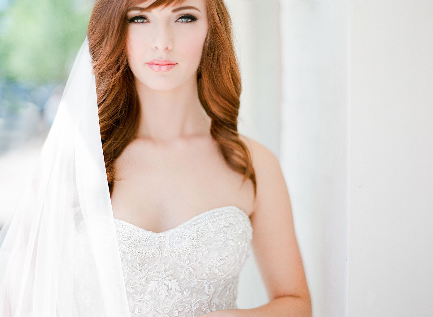 bride is wearing monique lhuillier from ivory & white