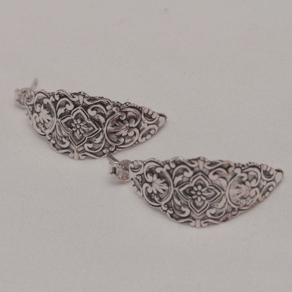 Ornate sterling silver stud earrings with floral design.
